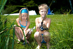 Young girl and boy fishing Royalty Free Stock Image