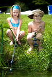 Young girl and boy fishing Royalty Free Stock Photos