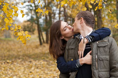 Young girl and boy kissing Stock Photo