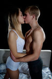 Young girl and boy kissing Stock Image