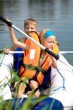Young girl and boy at a lake Royalty Free Stock Photos
