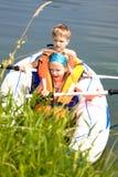 Young girl and boy at a lake Stock Image