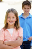 Young girl and boy outdoors Royalty Free Stock Photo