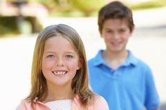 Young girl and boy outdoors Stock Photo