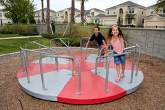 Young Girl and boy on Playground stock images