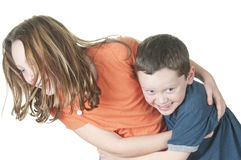 Young girl and boy playing. Tickle game Stock Photo