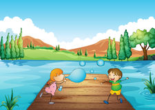 A young girl and boy playing with the bubbles Royalty Free Stock Photo