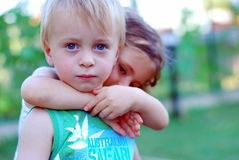 Young girl and boy together stock images
