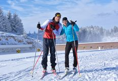 Young girl and a boy training at Cheile Gradistei Biathlon Arena - Cross country skiing Royalty Free Stock Images