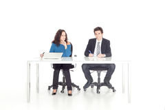 Young girl and boy working at their desk Stock Photos