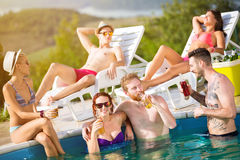 Young girl with boyfriend and friends at pool Royalty Free Stock Image