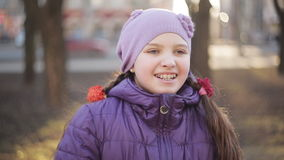 Young girl in braces cute smiling in the spring park stock video footage