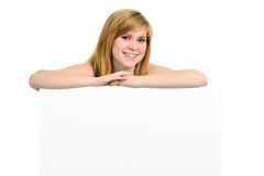 Young girl with brackets and white billboard Stock Photography