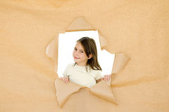 Young girl breaking through Royalty Free Stock Photo