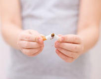 Young girl is breaking a cigarette Royalty Free Stock Photos