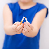 Young girl is breaking a cigarette Royalty Free Stock Photo