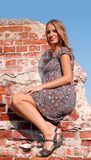 Young girl at the brick wall Stock Photo