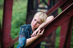 Young  girl is  on bridge bearing Royalty Free Stock Images