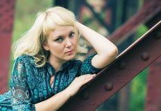 Young  girl is  on bridge bearing Stock Photos