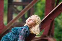 Young  girl is  on bridge bearing Stock Photo