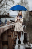 Young girl on a bridge on a cloudy rainy day Royalty Free Stock Image