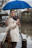 Young girl on a bridge on a cloudy rainy day Stock Photography