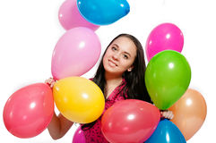 Young girl with bright colored balloons on a white Royalty Free Stock Photos