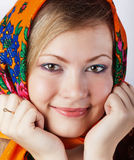 Young girl in a bright head scarf Royalty Free Stock Photography