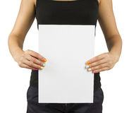 Young girl with bright manicure keeps empty paper sheet Stock Photos
