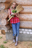 Young girl with broom and flowers Stock Photos