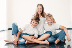 Young girl with brothers Stock Photos