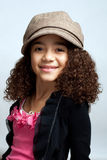 Young girl in brown hat Royalty Free Stock Photography