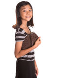 Young Girl With Brown Purse I Royalty Free Stock Photography