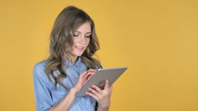 Young girl browsing internet, using tablet. 4k high quality stock video