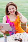 Young girl browsing trendy tablet pc Royalty Free Stock Photos