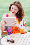 Young girl browsing trendy tablet pc Royalty Free Stock Images