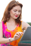 Young girl browsing trendy tablet pc Stock Images