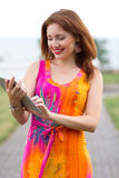 Young girl browsing trendy tablet pc Stock Photography