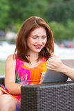 Young girl browsing trendy tablet pc Stock Photos