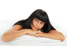 Young girl - brunette on white bed Stock Photography