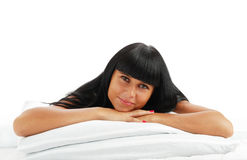 Young girl - brunette on white bed Royalty Free Stock Image