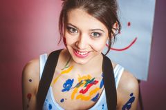 a young girl is stained with paint. royalty free stock photos