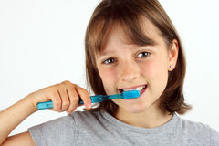 Young girl brushing her teeth Stock Photos