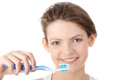 Young girl brushing her teeth happily Stock Images