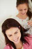 Young girl brushing mother's hair Royalty Free Stock Photography