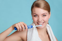 Young girl brushing oral cavity. Stock Photo