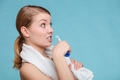 Young girl brushing oral cavity. Stock Images