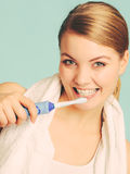 Young girl brushing oral cavity. Royalty Free Stock Photography