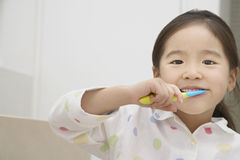 Young Girl Brushing Teeth Royalty Free Stock Photo