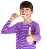 Young Girl Brushing Teeth IX Royalty Free Stock Image